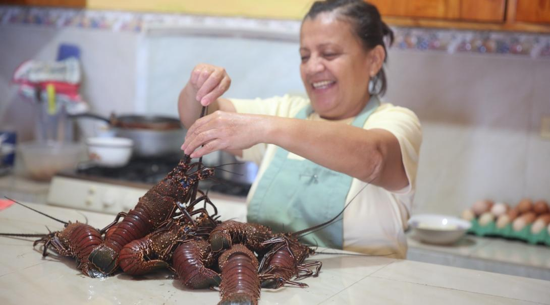 A host mom prepares a meal for her students who live with her while they learn Spanish in Ecuador.